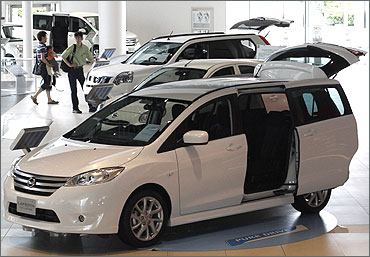 People look at cars from Nissan Motor.