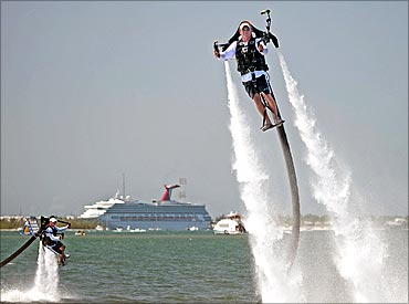 Scott Oosting (L) and Dave Tuxbury (R) go airborne with jetpacks.
