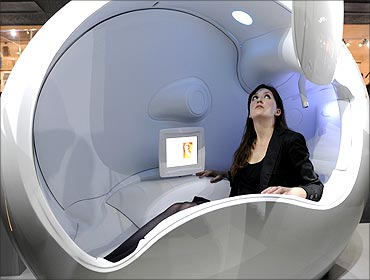 Kerry Law, an employee at the Science Museum, poses in a Wellbeing Capsule.