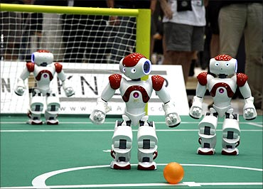 Humanoid robots compete in a soccer match the RoboCup 2009 in Graz.