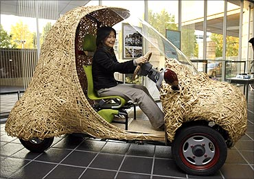 Bamgoo, an electric car with a body made out of bamboo, is displayed in Kyoto.
