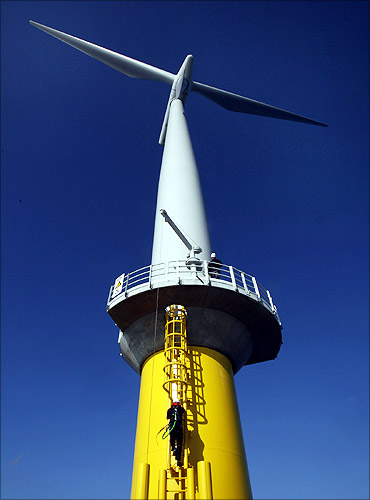 A worker climbs the ladder to a windmill at Horns Rev 2, the world's largest wind farm.