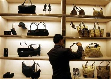 An employee arranges bags at a Gucci showroom in Mumbai