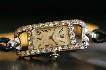 A very fine enamel and diamond cocktail watch made by Cartier in 1924