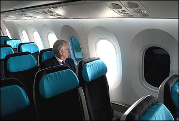 A Boeing employee sits next to a tinted window on the Boeing 787 Dreamliner at Farnborough airport.
