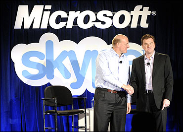 Microsoft CEO Steve Ballmer (L) and Skype CEO Tony Bates.
