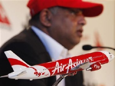 Air Asia CEO Tony Fernandes answers a question during a news conference