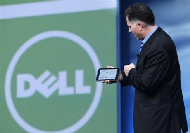 Dell founder and CEO Michael Dell displays a Dell tablet computer