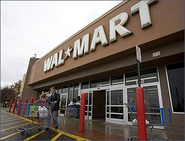 Shoppers cart their purchases from a Wal-Mart store in Alexandria, Virginia.