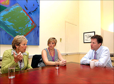 Britain's Deputy Prime Minister Nick Clegg (R) meets members of the 'Hacked Off' group.