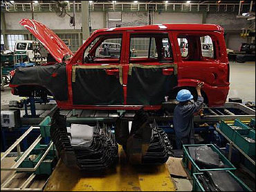 A mechanic works at a Mahindra and Mahindra car factory in Nashik.