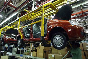 Engineers work on a car body at Tata Motors Ltd in Pune.