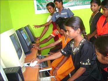 Village children attend a computer class.
