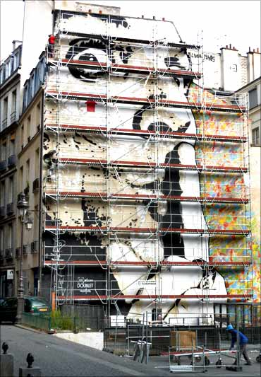 The giant wall stencil by French street artist Jef Aerosol which appears on a six-story building in central Paris.