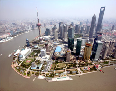 An aerial view shows Shanghai's new financial district skyline along the Huang Pu river in Shanghai.