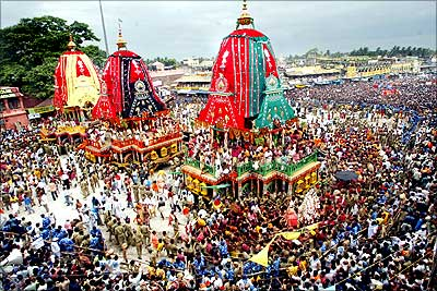 Devotees gather around the chariots of Lord Jagannath during the Puri chariot festival in Orissa.