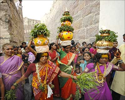 Devotees take part in the annual religious festival, Bonalu, in Hyderabad.