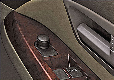 Maruti SX4 driver's side inside door control interior.