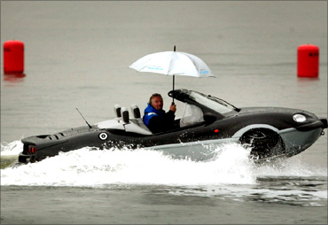 Richard Branson in an amphibious car.