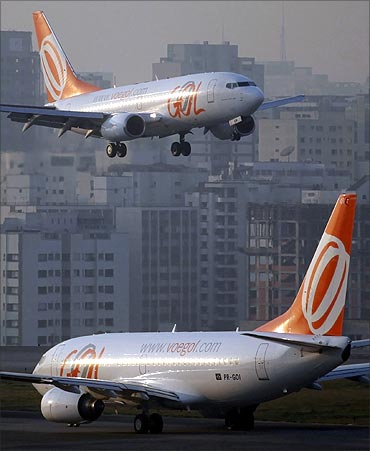 A Brazilian airline Gol aircraft (top) prepares to land at Congonhas airport in Sao Paulo.