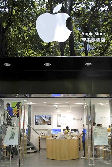 Customers and employees are seen in a fake Apple store in Kunming.