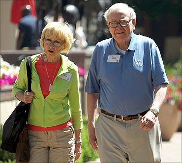 Berkshire Hathaway chairman and CEO Warren Buffett (R) and his wife Astrid Buffet.