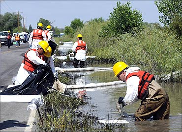 Emergency response crew hired by Exxon Mobil clean up an oil spill along the Yellowstone River.