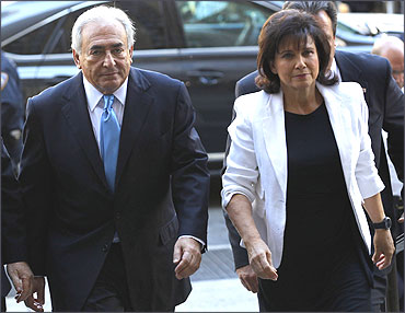 Strauss-Kahn and his wife Anne Sinclair arrive for a hearing at the New York State Supreme Courthouse.