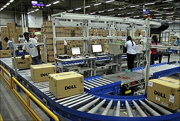 Computers packed into boxes are transported on a conveyor belt at a Dell factory in Sriperumbudur.
