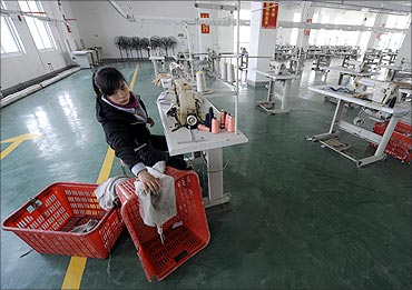An employee works at a garment factory of Hefei Shichao Clothing Co in Hefei, Anhui province.