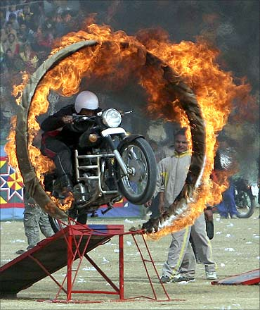 An Indian policeman performs a stunt during the Republic Day celebrations in Jammu.