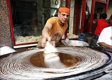 An Egyptian man prepares kunafa, a traditional Middle Eastern dessert, on the first day of Ramadan in Cairo.