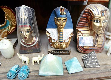Souvenirs wrapped in plastic sit on a shelf at a tourist store in the Khan al-Khalili area of Cairo.