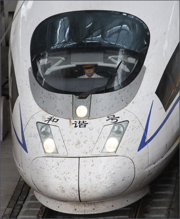A driver is seen inside a CRH (China Railway High-speed) Harmony bullet train at Beijing South Railway Station.