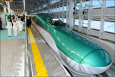 The Hayabusa shinkansen or bullet train departs from Aomori station.