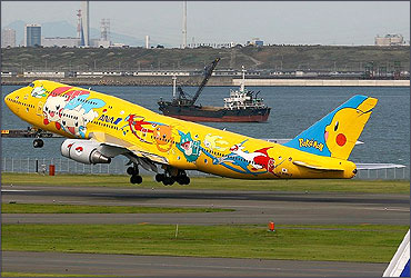 An ANA Boeing 747-400 in a Pokemon livery takes off from Tokyo International Airport.