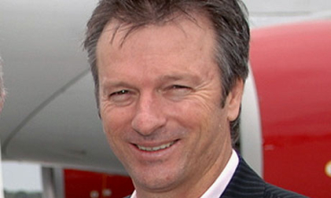 Jain has a shirt signed by Steve, pictured above, and Mark Waugh.
