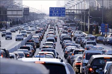 Vehicles are seen in a traffic jam during weekday rush hour in Beijing.
