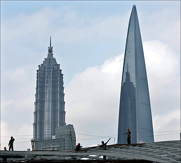 Migrant labourers work at a construction site in downtown Shanghai.
