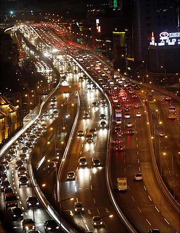 Vehicles drive during the evening rush hour in central Shanghai.