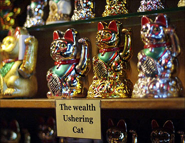 Rows of Maneki Neko, also known as Fortune Cats, are displayed for sale during the Lunar New Year.