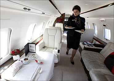 A Vistajet flight attendant prepares a breakfast in a Bombardier 605 aircraft in Geneva.