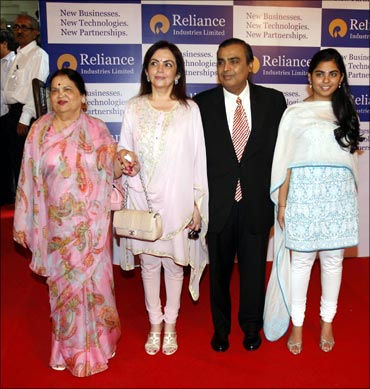(From Left) Kokilaben Ambani, Nita Ambani, Reliance Industries chairman Mukesh Ambani and his daughter Isha at the 37th AGM of Reliance Industries Ltd in Mumbai on Friday.