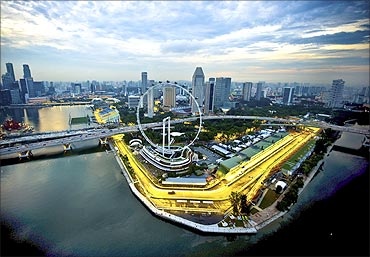 The Marina Bay street circuit of the Singapore Formula One Grand Prix is seen illuminated at dusk.