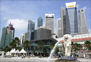 The Singapore Merlion is seen in front of the city centre.