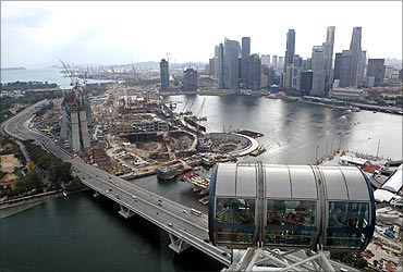Skyscrapers of financial district and the construction site of the Marina Bay Sands casino resort.