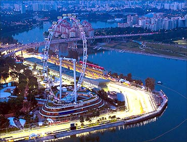 An aerial view at dusk shows part of the illuminated Marina Bay street circuit of the Singapore.
