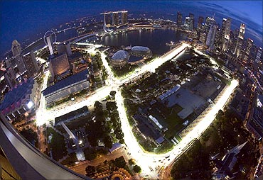An aerial view shows the illuminated Marina Bay street circuit of the Singapore Formula 1 Grand Prix