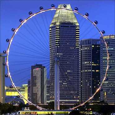 The Singapore Flyer observation wheel is pictured at dusk.
