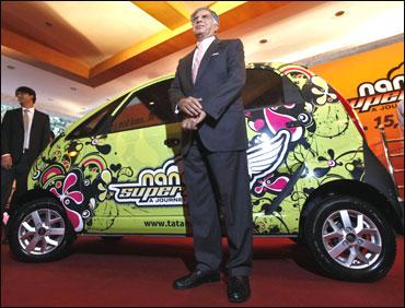 Ratan Tata poses poses with a Nano.